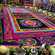 Sometimes beautiful things (like these sawdust carpets created for Latin American Easter celebrations) coexist with ugliness -- and it's just not fair.